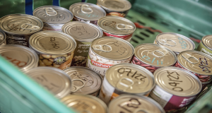 North Bristol Food Bank soup cans in green crate