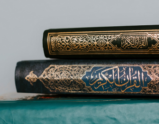 Religious texts in Islam laid on blue table