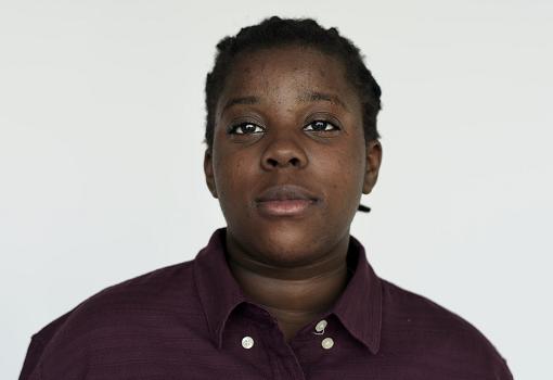 Young Black woman in purple shirt