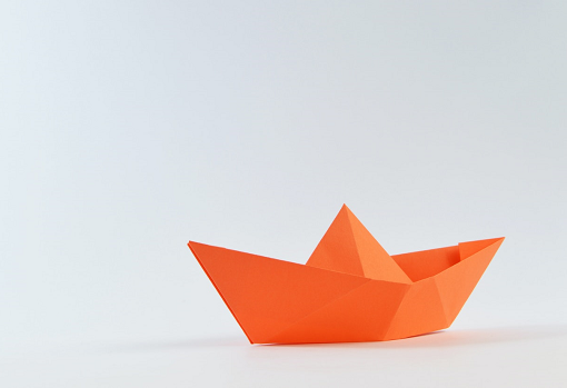 Orange boat made from paper - origami