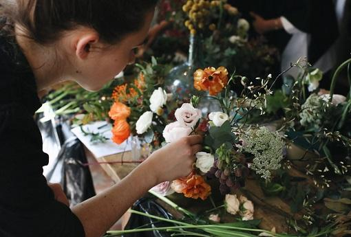 Flowers arranged in tribute by bereaved person