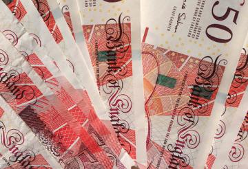 £50 pound notes arranged flat