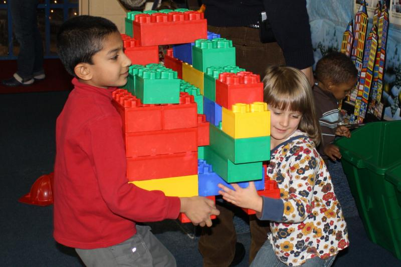 Children building things together with lego
