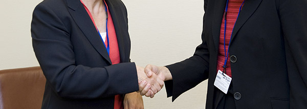 Photo of two women shaking hands