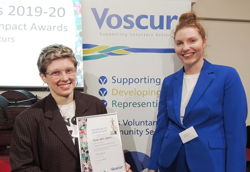 Rising Arts Agency staff collect their award at the Voscurs