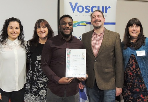 WECIL with their Voscur award for inclusion