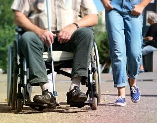 Wheelchair user and friend